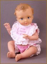 Jesus Loves Me baby doll by Ashton Drake company.